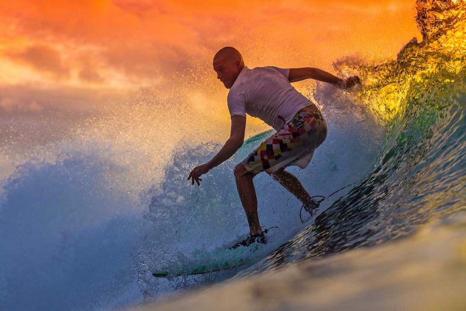 Surfer at sunset in Bali, Indonesia. Photo: Shutterstock