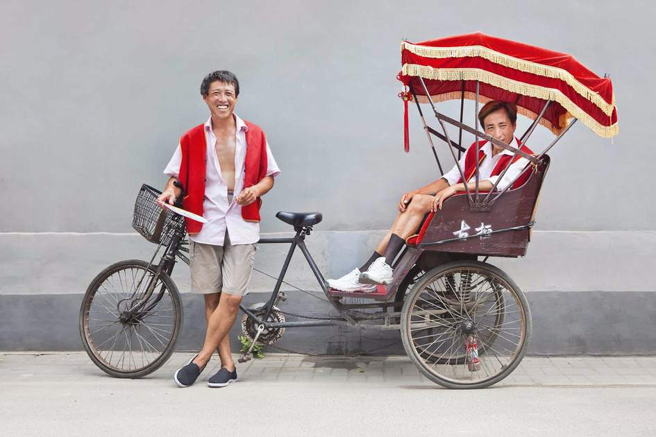 Beijing rickshaw drivers having a break