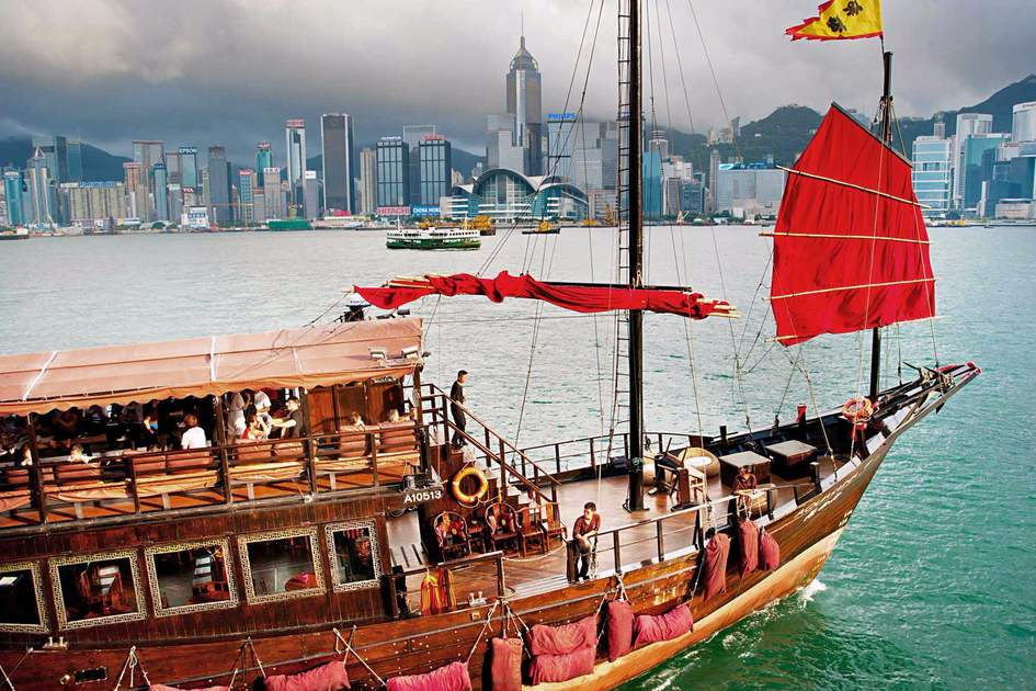 Traditional chinese-style tourist Aqua Luna junk sailing in Hong Kong harbor. Photo: Shutterstock