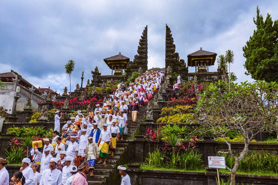 Prayers in Pura Besakih Temple in Bali Island, Indonesia.