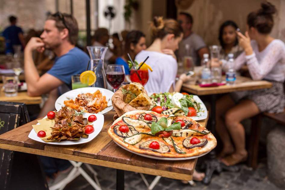 Enjoying italian food. Photo: Shutterstock
