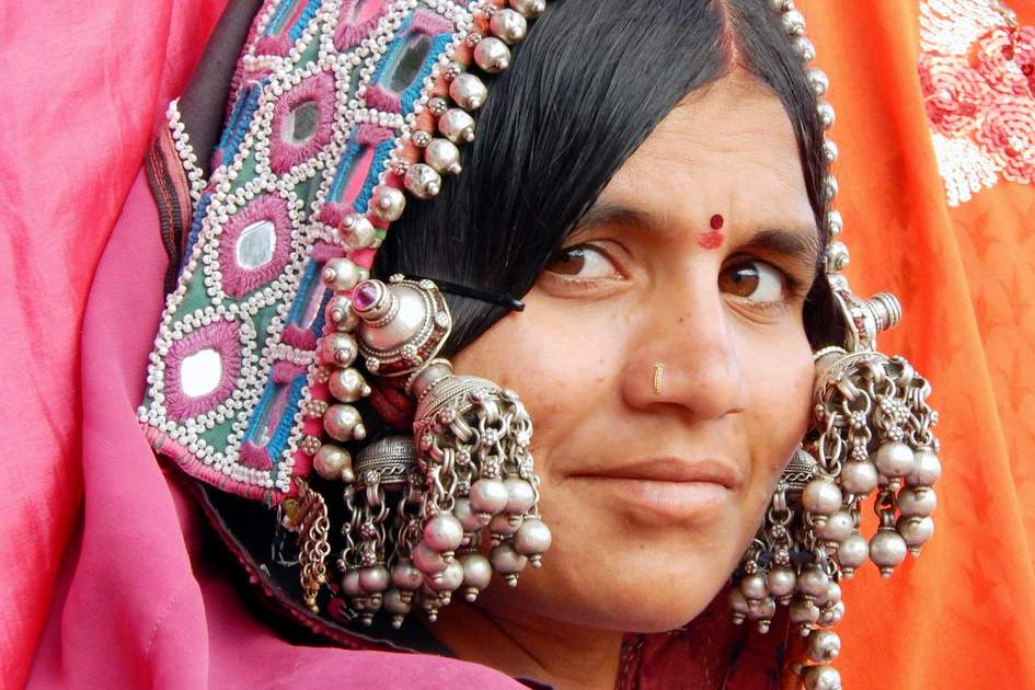 :Closeup portrait of an Indian banjara woman with silver ornaments and colorful dress on in Hyderabad, India.