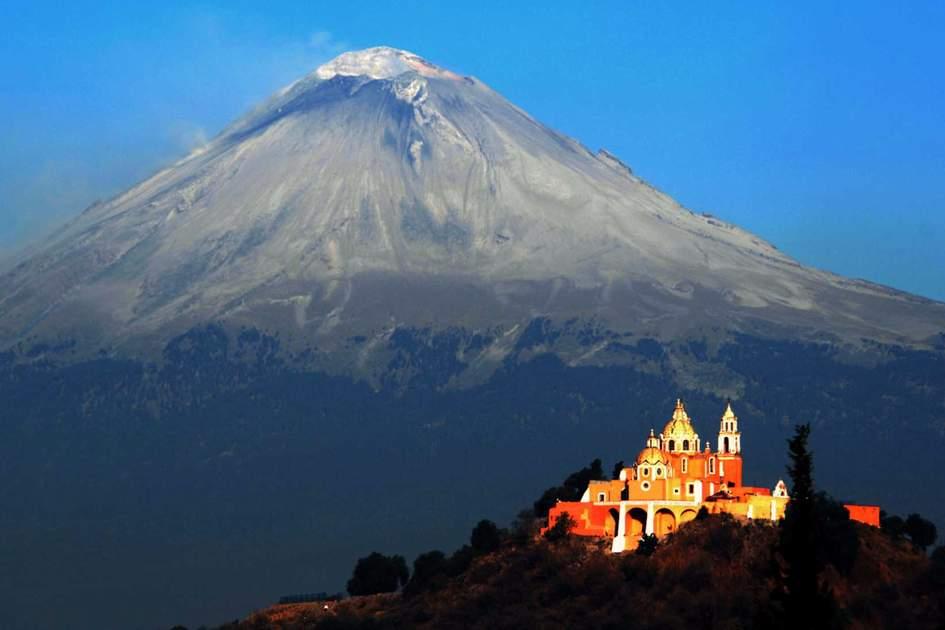 Popocatepetl Volcano above el Santuario de Nuestra Señora de los Remedios in Puebla. Photo: Shutterstock