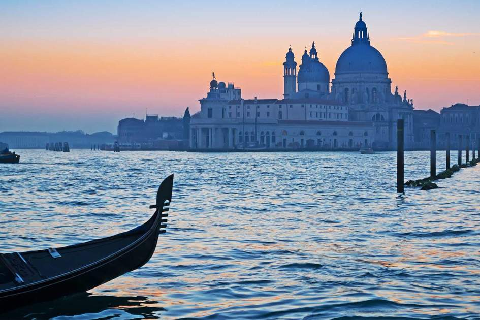 Gondola in Venice Grand Canal at sunset. Photo: Shutterstock