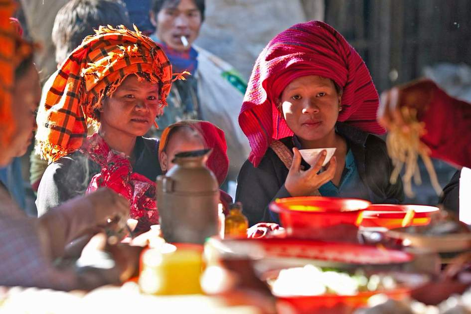 Burmese Pa-O tribe women at street stall in Sanghar