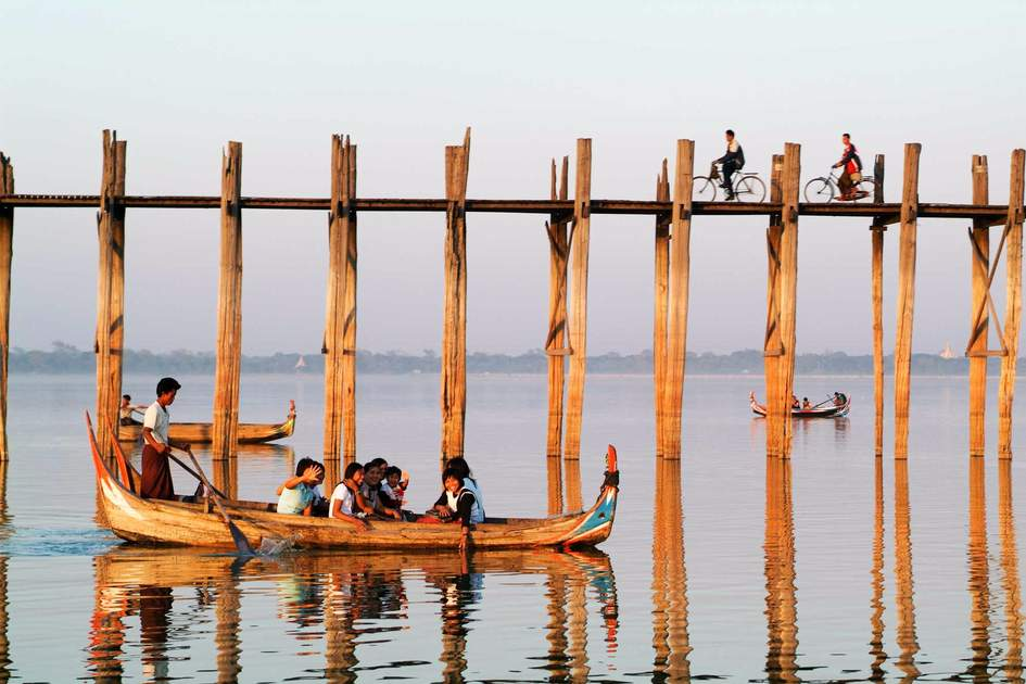 People walking on the wooden bridge of U Bein on river Ayeyarwad, Myanmar. Photo: Shutterstock