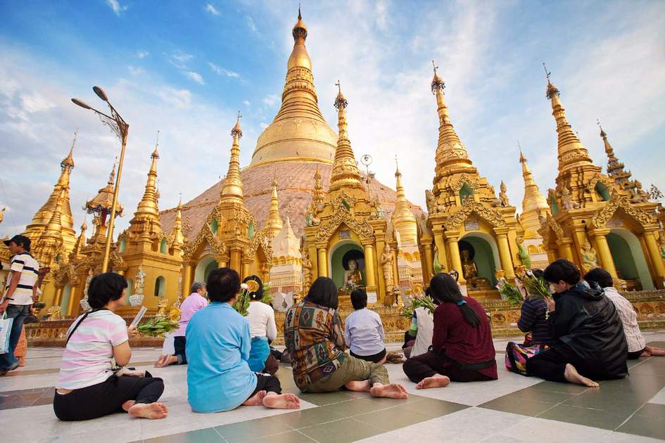 Buddhist devotees pray at the full moon festival, Shwedagon Pagoda in Yangon. Photo: Shutterstock