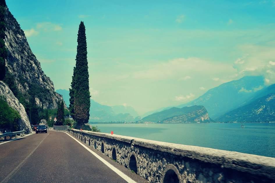 Driving next to Lake Garda in summertime.