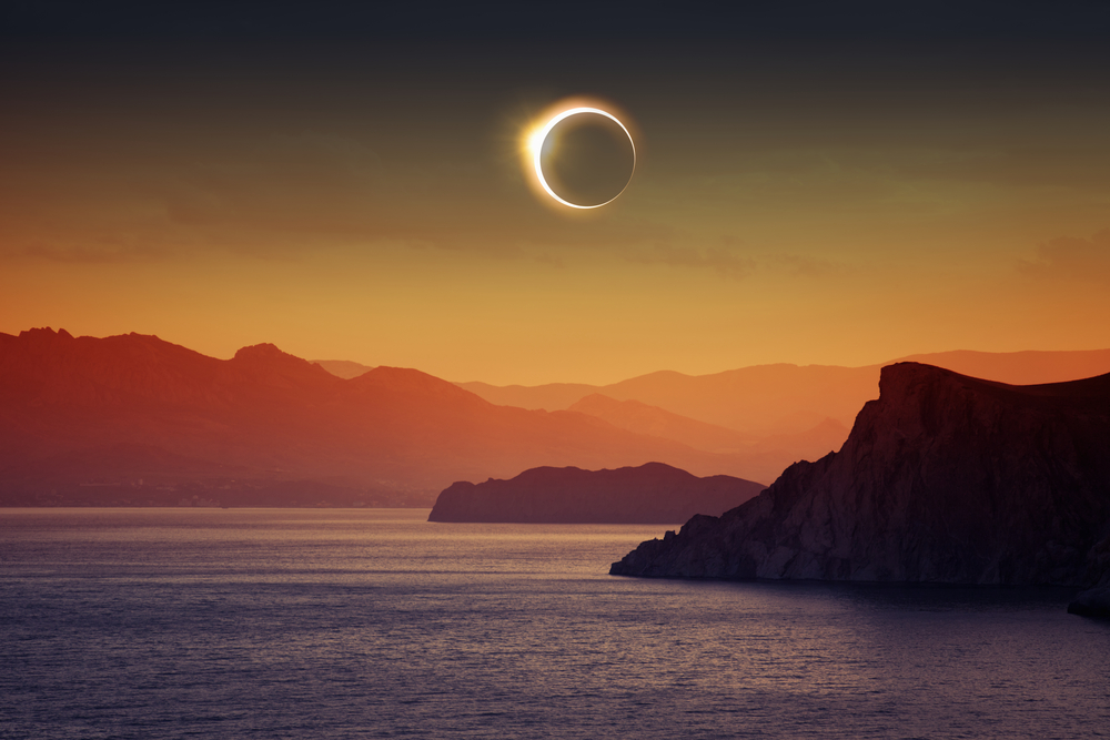 A total solar eclipse over the coast