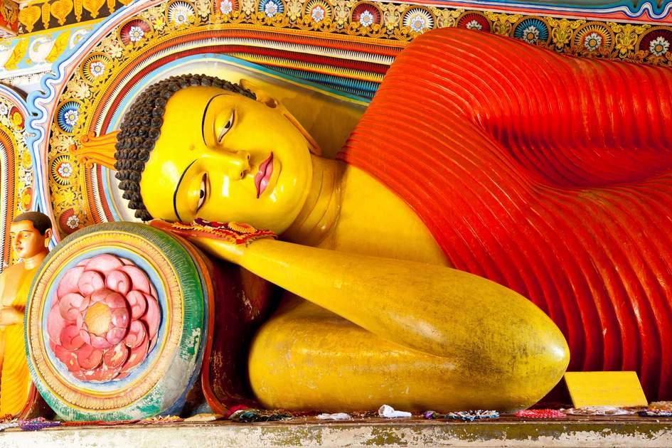 Reclining Buddha at Isurumuniya Temple, Anuradhapura, Sri Lanka. Photo: Shutterstock
