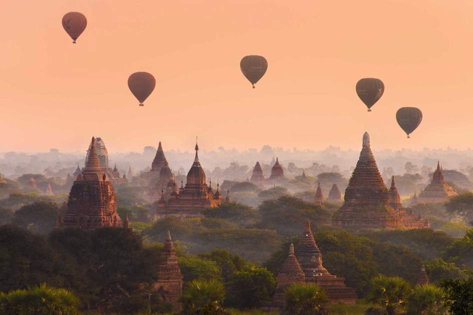 Hot air balloons fly over the ancient pagodas of Bagan. Photo: Shutterstock