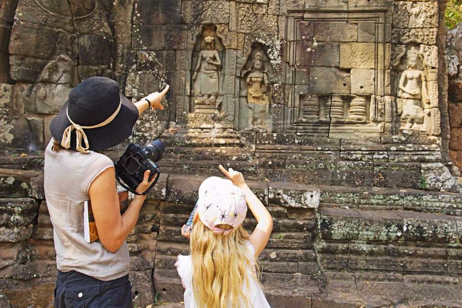 Mother and daughter looking at ancient temple in Cambodia. Photo: Shutterstock