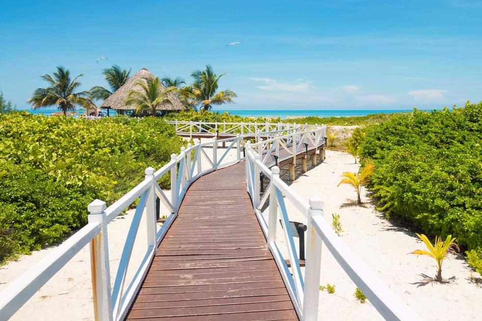 Wodden walkway leading to a beautiful beach in Cuba. Photo: Shutterstock