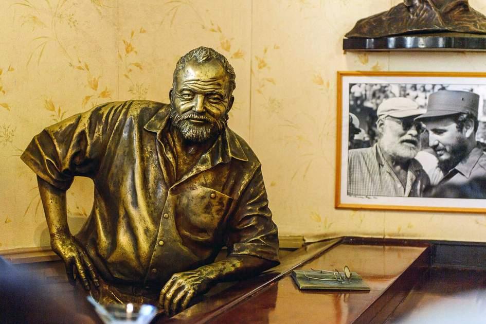 Hemingway sculpture in El Floridita, a historic fish restaurant and cocktail bar La Habana Vieja, Cuba. Photo: Shutterstock
