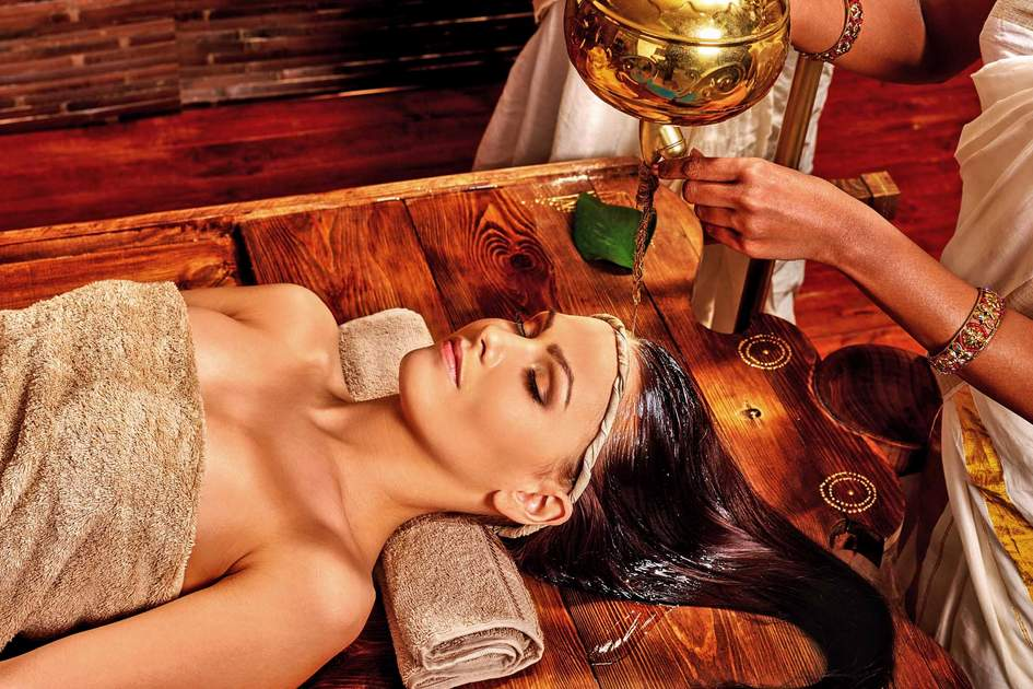 Oil head Ayurveda Shirodhara treatment. Photo: Shutterstock
