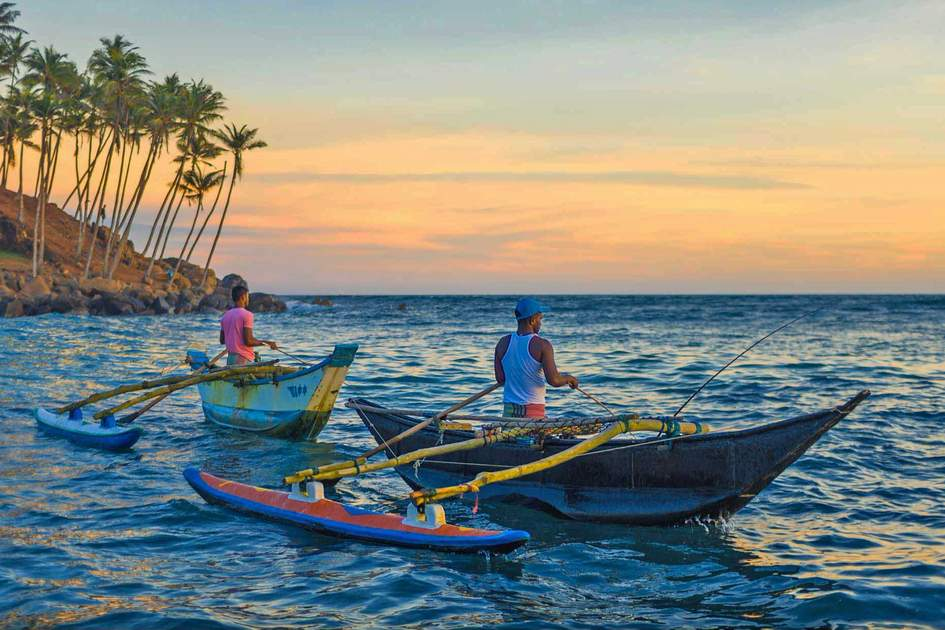 Fishermen from Mirissa in a traditional Sri Lanka's boat for fishing at sunset. Photo: Shutterstock