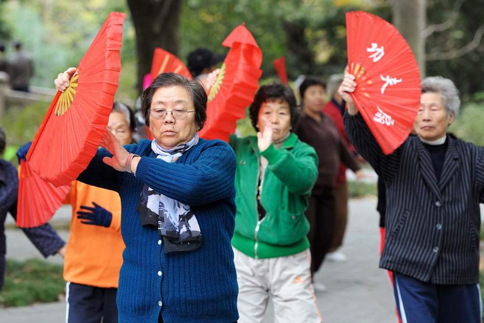 Senior citizens practice Tai Chi in People's Park in Shanghai. Photo: Shutterstock