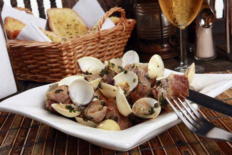 Traditional Portuguese pork and clams – porco a Alentejana. Photo: Shutterstock