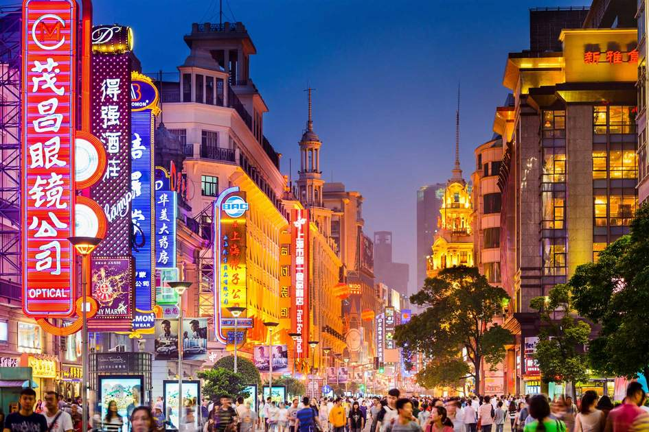 Neon signs lit on Nanjing Road. The area is the main shopping district of the city and one of the world's busiest shopping streets. Photo: Shutterstock