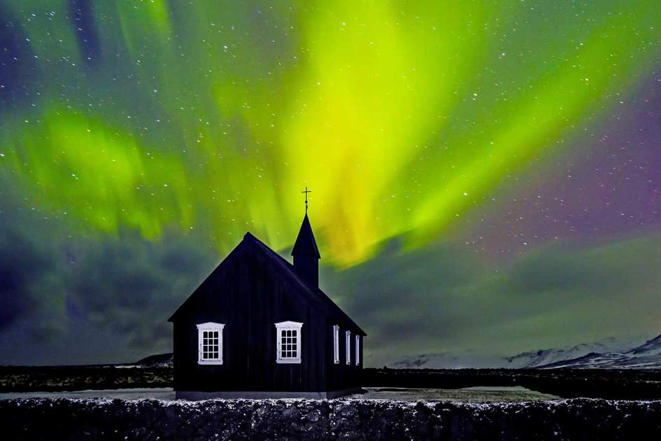 Northern lights over Budhir Church in Iceland. Photo: Shutterstock