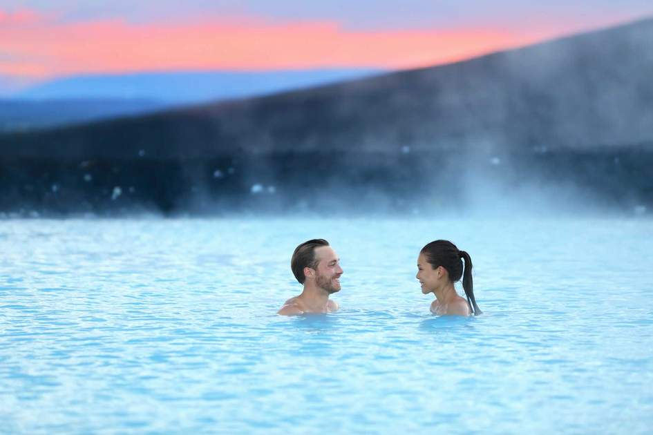 Relaxing at the Blue Lagoon hot spring in Iceland. Photo: Shutterstock