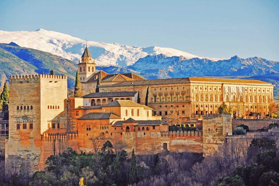 Alhambra Palace in Granada, Andalusia with Sierra Nevada mountains in the background. Photo: Shutterstock