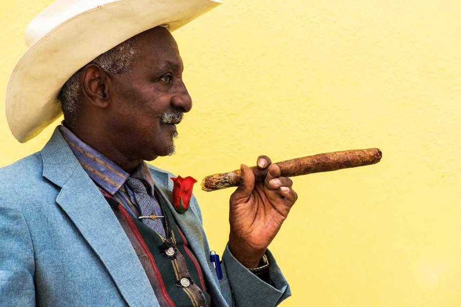 A Cuban smoking a cigar. Photo: Shutterstock