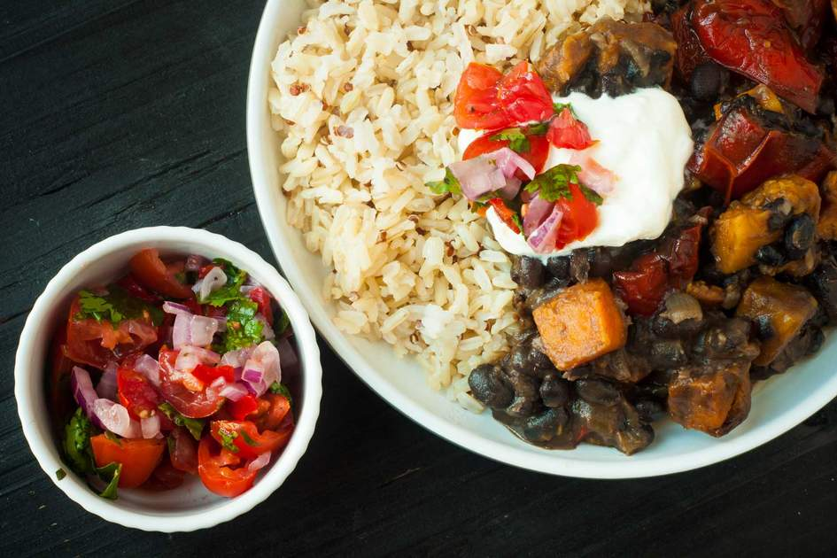Vegetable feijoada. A vegetarian version of the popular Brazilian dish made with black beans, butternut squash and served with rice and salsa. Photo: Shutterstock
