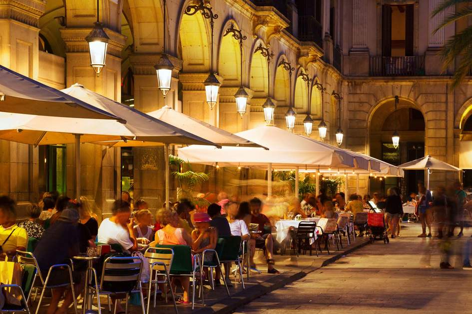 Placa Reial in summer night. Barcelona. Photo: Shutterstock