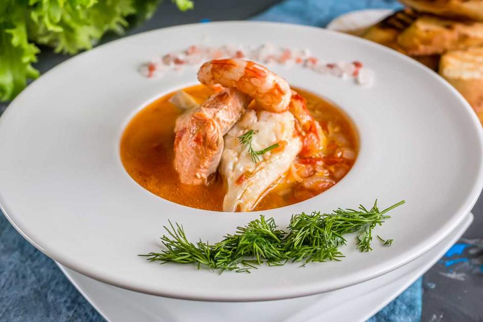 Marseille's speciality: Bouillabaisse with seafood, salmon fillet, shrimp. Photo: Shutterstock