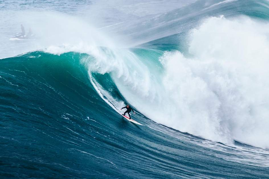 Surfing big waves in Nazaré, Portugal. Photo: tomasgehrhardt/Shutterstock