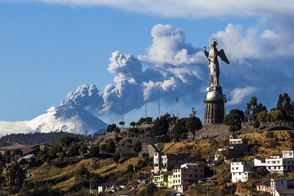 Cotopaxi volcano eruption and Panecillo's Madona, Ecuador. Photo: Ecuadorpostales/Shutterstock