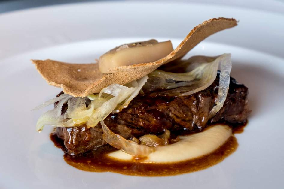 Grilled beef and bone marrow with bordelaise sauce. Photo: Shutterstock