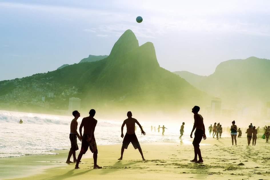 Playing football at Ipanema Beach, Rio de Janeiro. Photo: lazyllama/Shutterstock