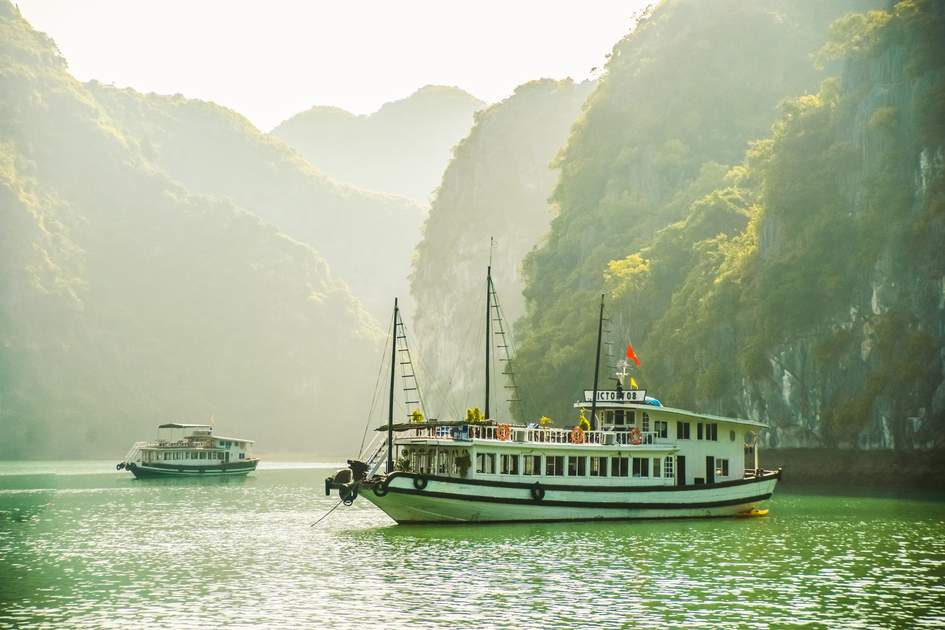 Boats among limestone crags of Ha Long Bay, Vietnam. Photo: Romas_Photo/Shutterstock