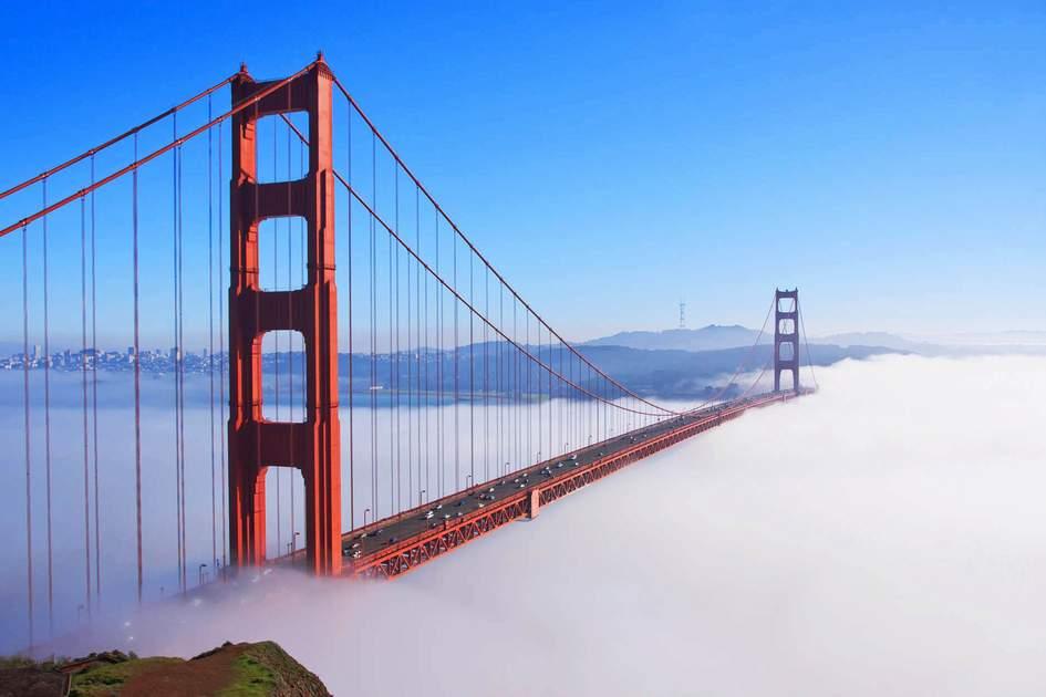 Thick fog covering Golden Gate Bridge, San Francisco. Photo: Radoslaw Lecyk/Shutterstock