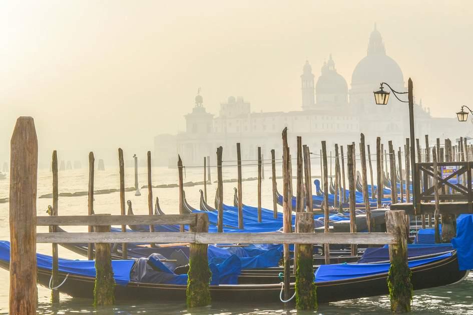 Gondalas and Basilica di Santa Maria della Salute at winter sunset, Venice. Photo: shekure/Shutterstock