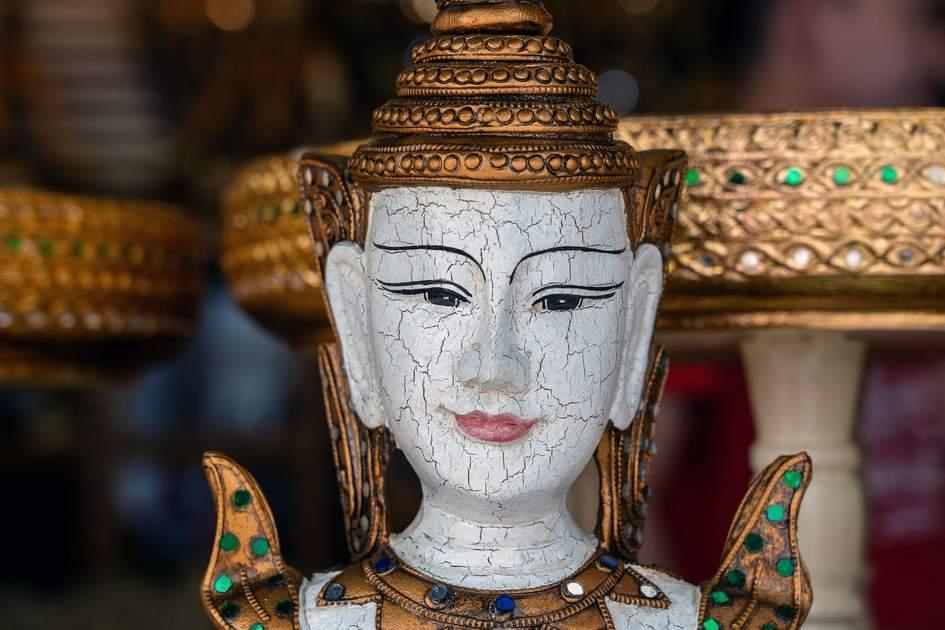 Bangkok street market statue. Photo: OlegD/Shutterstock