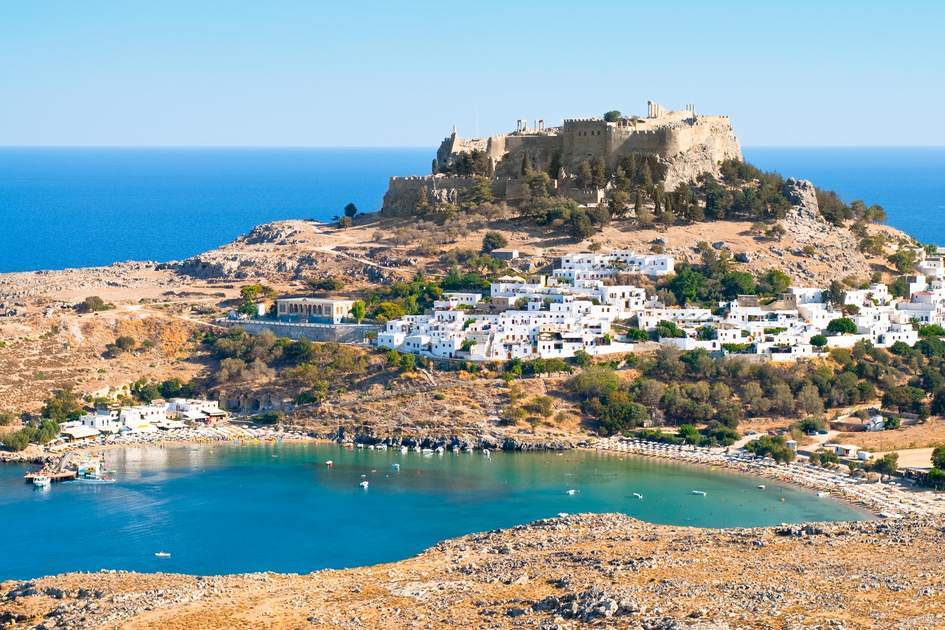 A visit to the Acropolis above the ancient town of Líndos on Rhodes, Greece, is one of the best things to do on the island. Photo: Photo.Lux/Shutterstock