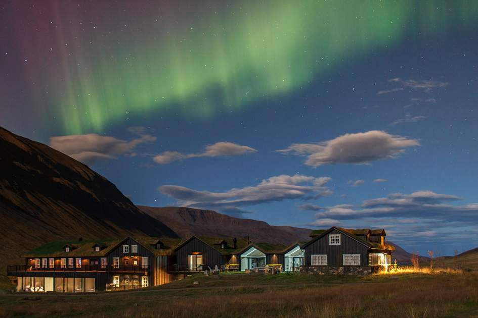 Aurora borealis over Deplar Farm lodge, one of the best hotels in Iceland to see the northern lights. Photo: Press release