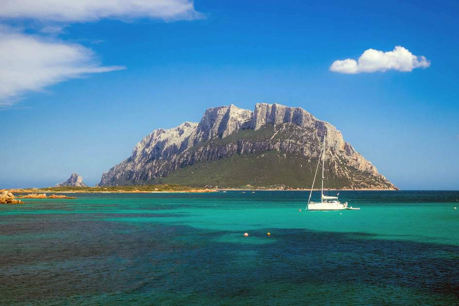 Swimming is possible at stunning beaches below the dramatic mountain peaks of Tavolara Island, off the east coast of Sardinia. Photo: Andreas Gerhardinger/Shutterstock