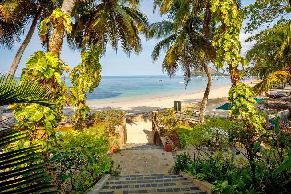 Pathway leading to an idyllic stretch of sand on the island of Nosy Be, where you can find some of the best beaches in Madagascar. Photo: Artush/Shutterstock