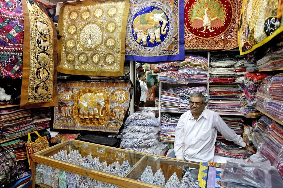 Salesman at his store in the Mutrah Souk. Fine textiles are some of the traditional Omani goods you can browse for when shopping in Muscat. Photo: Kevin Cummins/Apa Digital
