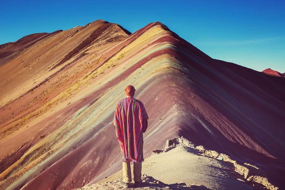 Hiking scene in Vinicunca, Cusco Region, Peru. Montana de Siete Colores, Rainbow Mountain. Photo: Galyna Andrushko/Shutterstock
