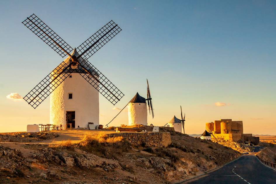 Spanish windmills and medieval castle on a hill in Consuegra, Castile-La Mancha, Spain. Photo: Vladimir Sazonov/Shutterstock
