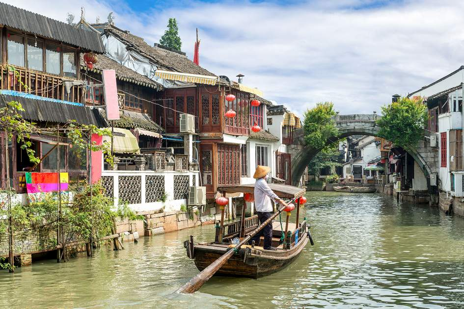 Empty traditional tourist boats on canals of Shanghai Zhujiajiao Water Town in Shanghai, China. Photo: Travelpixs/Shutterstock