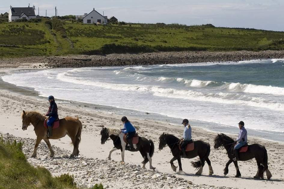 Horse-riding on Cleggan beach in Connemara, County Galway, (photo by Corrie Wingate)