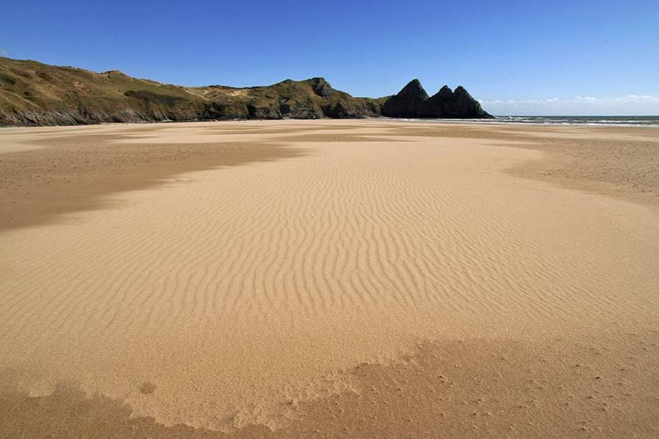 Three cliff bay at low tide, gower peninsula , (photo by iStock )