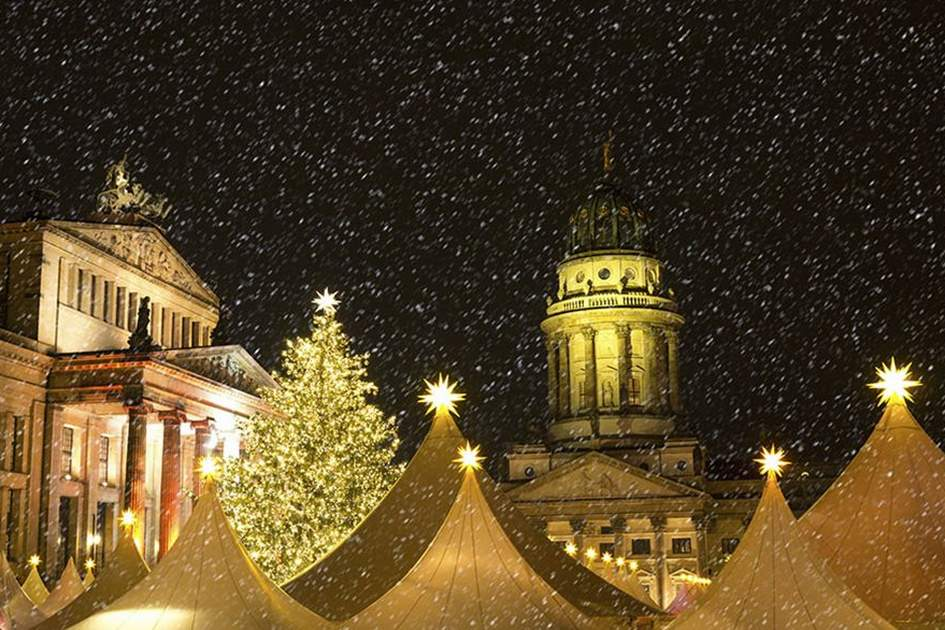 christmas market in berlin with snowflakes in december, (photo by iStock)
