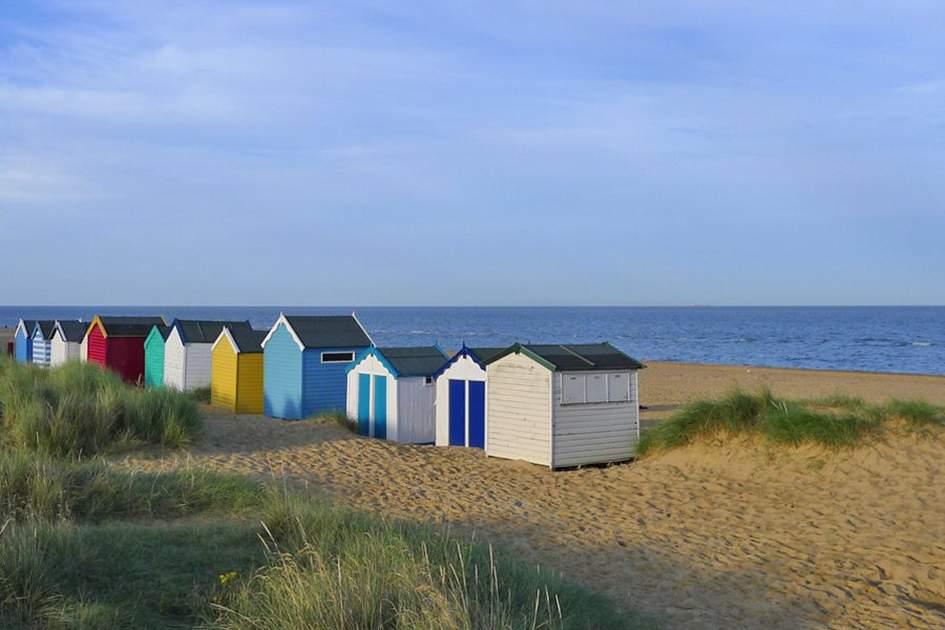 Beach Huts under Gun Hill in Southwold, Suffolk, (photo by James Macdonald)